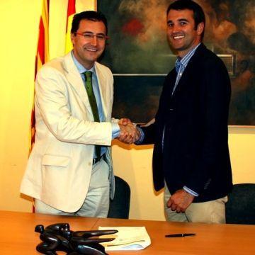 Miguel Ángel Machado y Joan Fontserè en la firma del acuerdo.